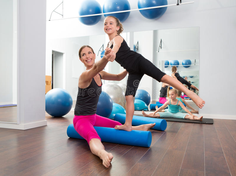 Aerobics woman personal trainer of children girl royalty free stock photos