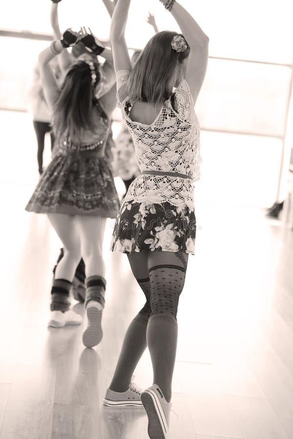 Aerobics. Women dancing at the aerobics class stock photos