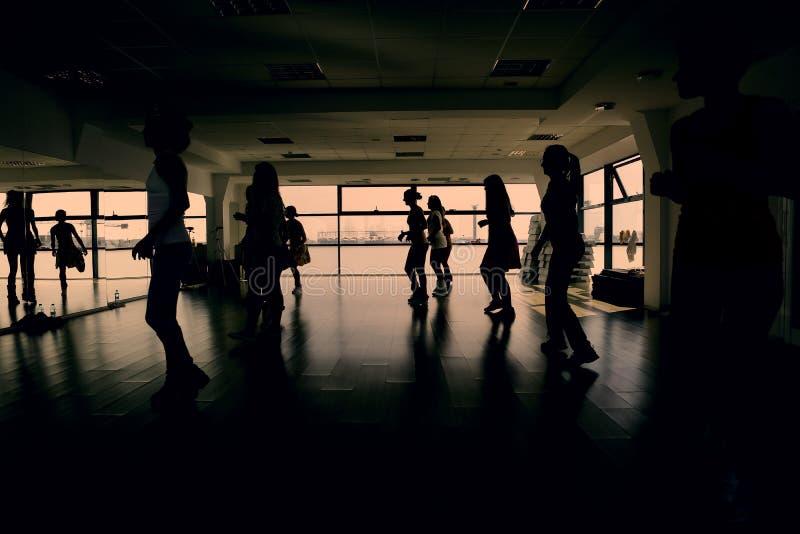 Aerobics. Women doing exercises in an aerobics class, silhouettes royalty free stock photos
