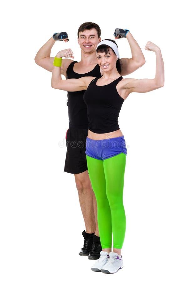 Aerobicskonditionpar som övar den isolerade oavkortade kroppen royaltyfri foto