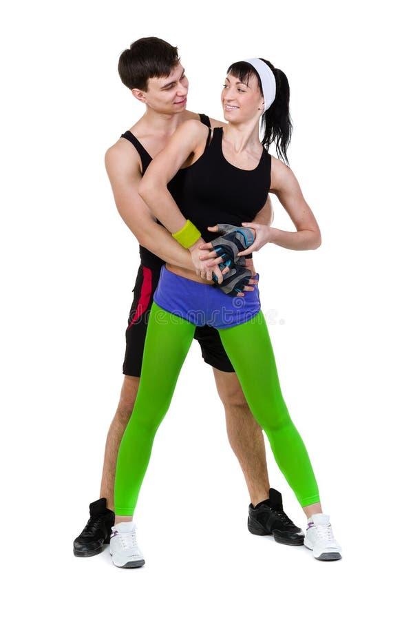 Aerobicskonditionpar som övar den isolerade oavkortade kroppen arkivbild