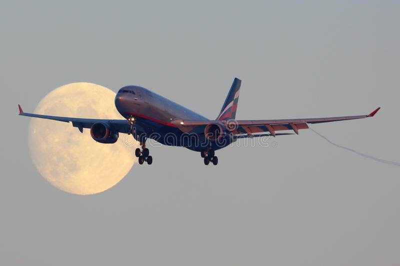 Aeroflot Airbus A330 VQ-BBF crossing the moon before landing at Sheremetyevo international airport. SHEREMETYEVO, MOSCOW REGION, RUSSIA - NOVEMBER 29, 2013 stock photography