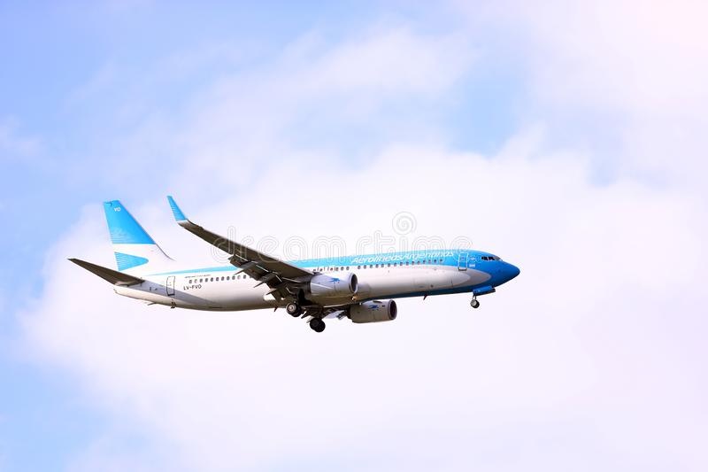 Aerolineas Argentinas plane flying over Buenos Aires royalty free stock photos