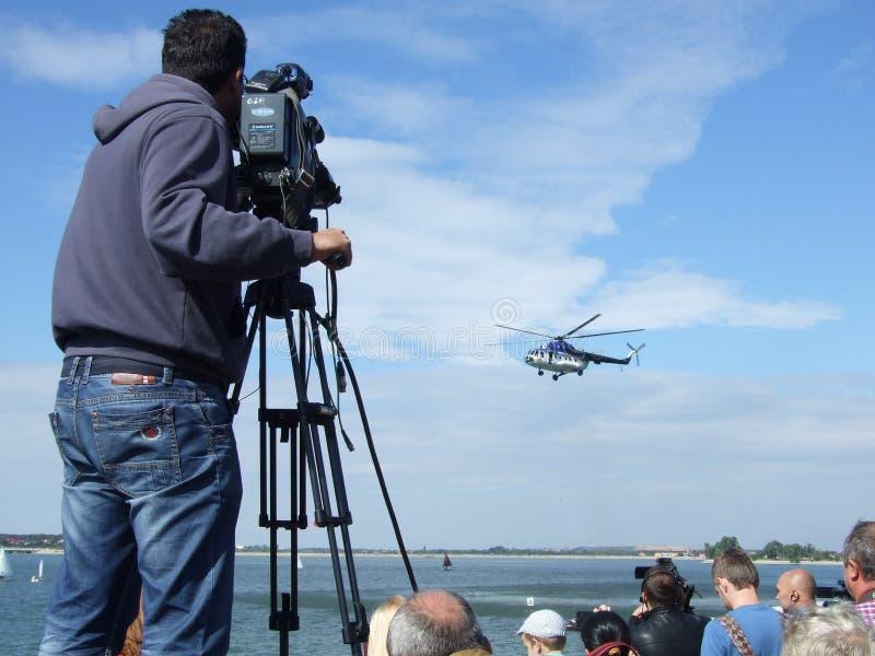 Aeronautic show 2013. Cameraman at Aeronautic show 2013 on Morii Lake in Bucharest, Romania royalty free stock images