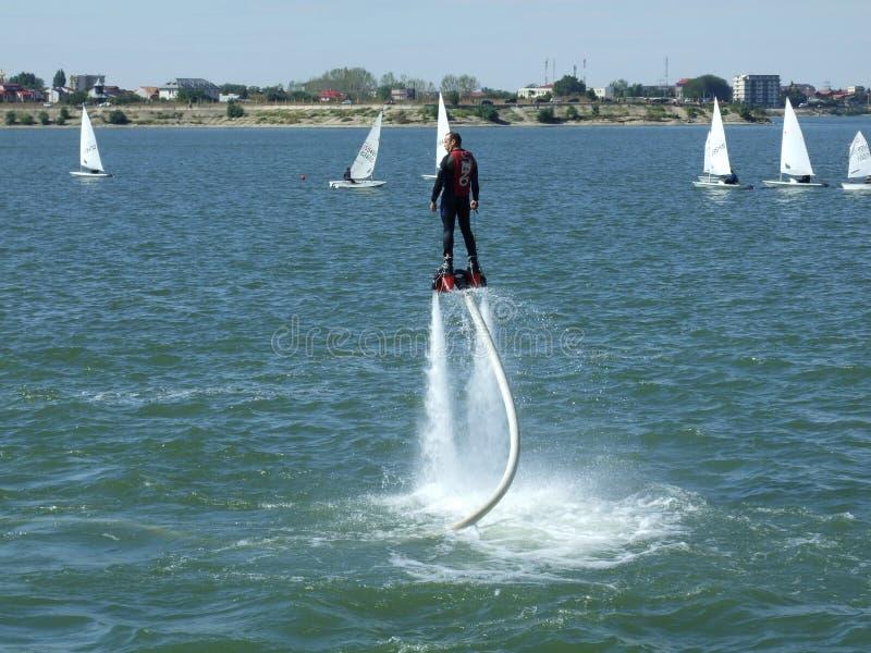 Aeronautic show 2013. Fly boarder at Aeronautic show 2013 on Morii Lake in Bucharest, Romania royalty free stock images