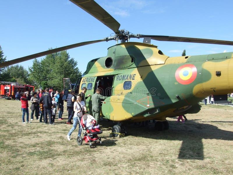 Aeronautic show 2013. People near helicopter Aeronautic show 2013 on Morii Lake in Bucharest, Romania royalty free stock photos