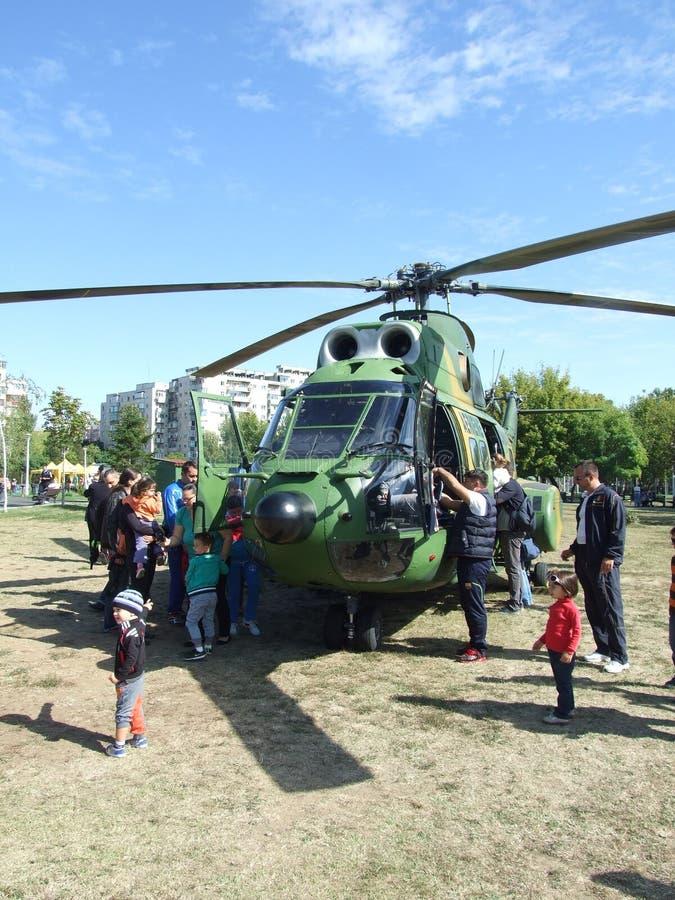 Aeronautic show 2013. People near helicopter Aeronautic show 2013 on Morii Lake in Bucharest, Romania stock image