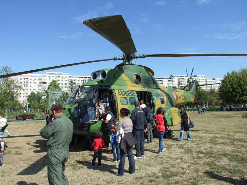Aeronautic show 2013. People near helicopter Aeronautic show 2013 on Morii Lake in Bucharest, Romania royalty free stock images