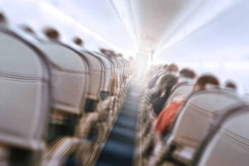 Plane shakes during turbulence flying through the air hole. Aerophobias concept. plane shakes during turbulence flying air hole. Blur image commercial plane stock photography