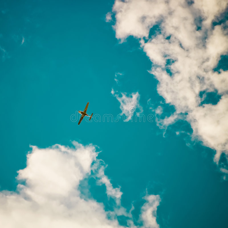 Aeroplane. Flying between clouds in the blue sky stock photos