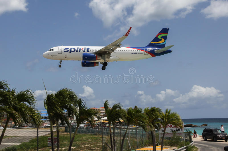 Aeroplane Airbus A320 Spirit is landing on Princess Juliana International Airport. ST. MAARTEN-AUGUST 1: Aeroplane Airbus A320 Spirit is landing on Princess stock photography