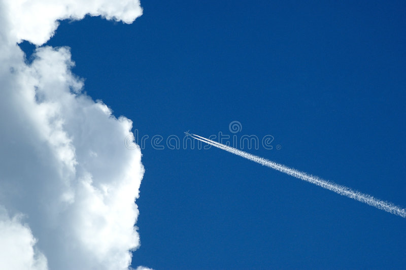 Aeroplane and cloud. Aeroplane flight on cloud with blue sky royalty free stock photography