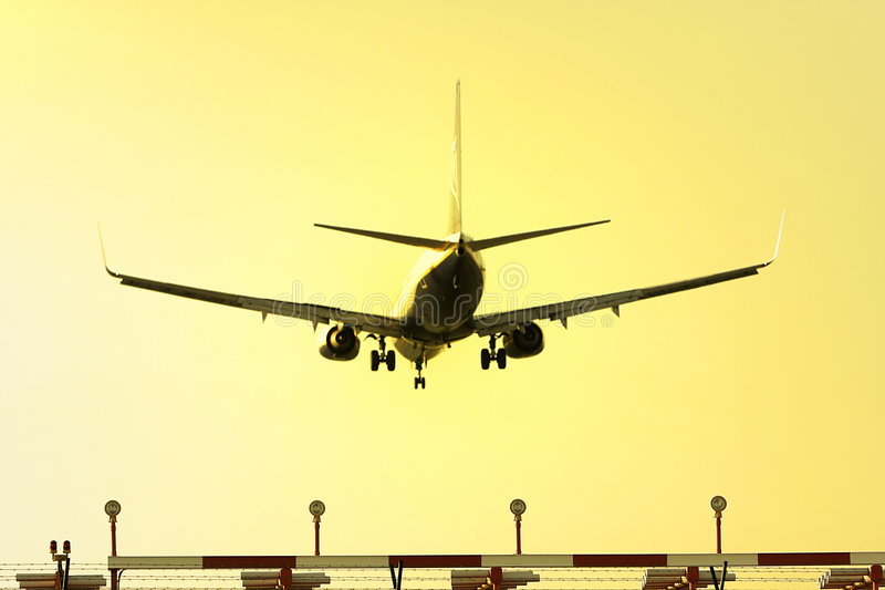 Aeroplane landing royalty free stock images