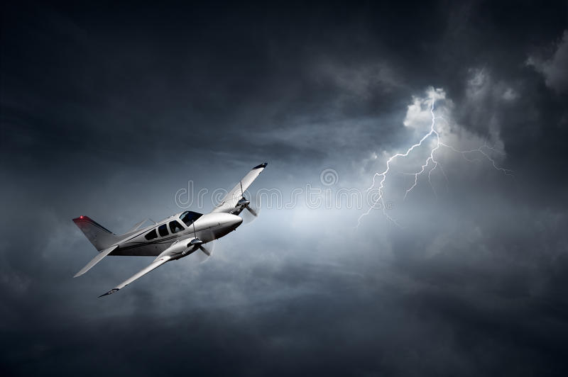 Aeroplane in thunderstorm. Aeroplane flying in storm with lightning (Concept of risk - digital artwork royalty free stock photography