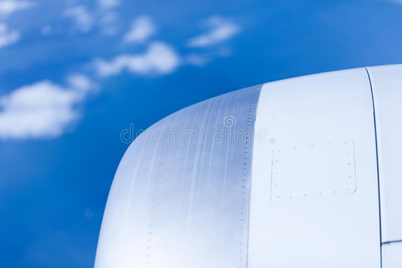 Aeroplane wing with blue sky and white clouds. Travel and tourism concept image. stock photos