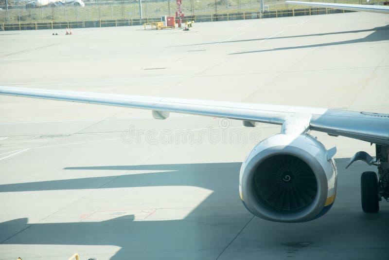 Aeroplane wing and Aeroplane engine royalty free stock image