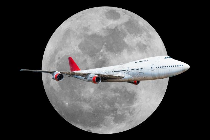 Aeroplano del pasajero con la luna en fondo negro fotografía de archivo libre de regalías
