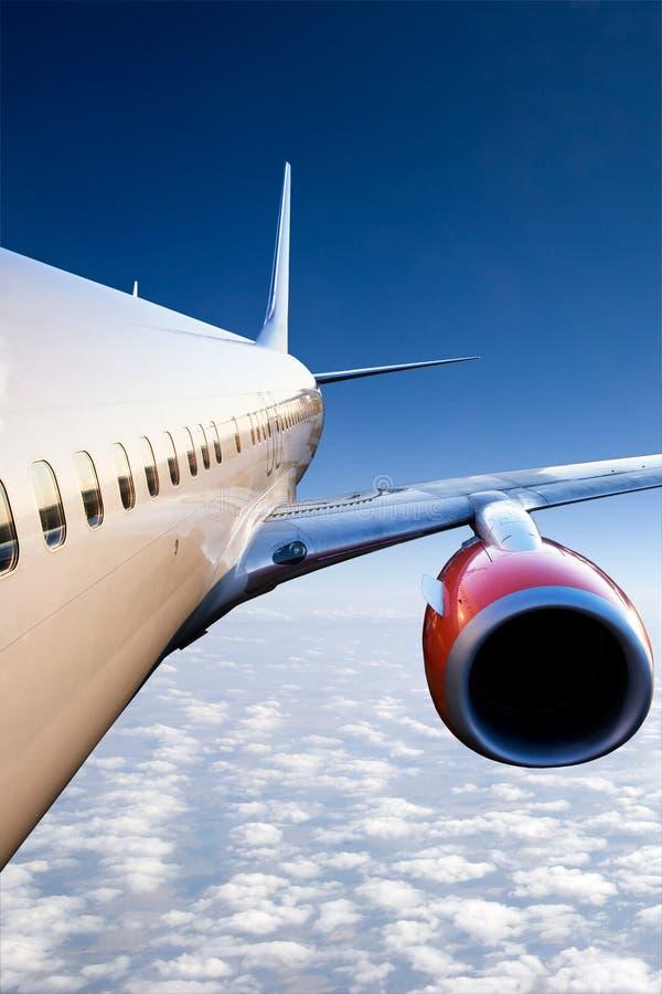 Aeroplano durante il volo fotografia stock