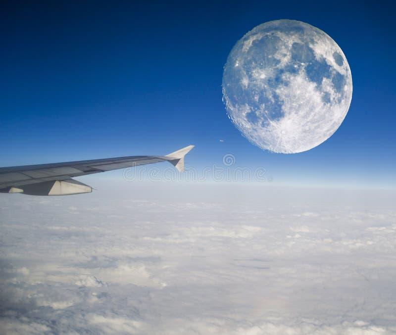 Aeroplano e luna immagini stock