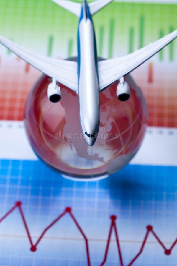 Aeroplano in finanze e mondo fotografia stock libera da diritti