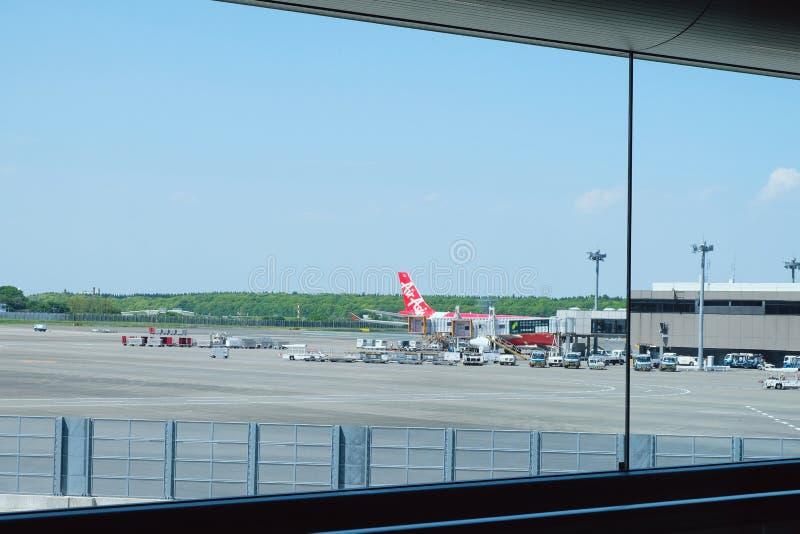 Aeroplano nell'aeroporto internazionale di Narita fotografie stock libere da diritti