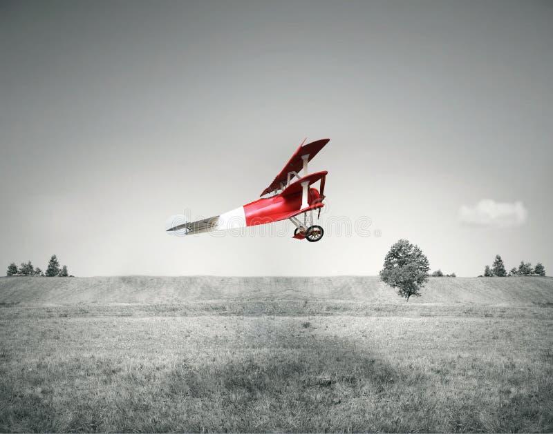 Aeroplano rojo de la vendimia imagenes de archivo