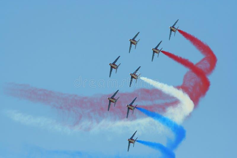 Aeroplanos patrióticos   foto de archivo