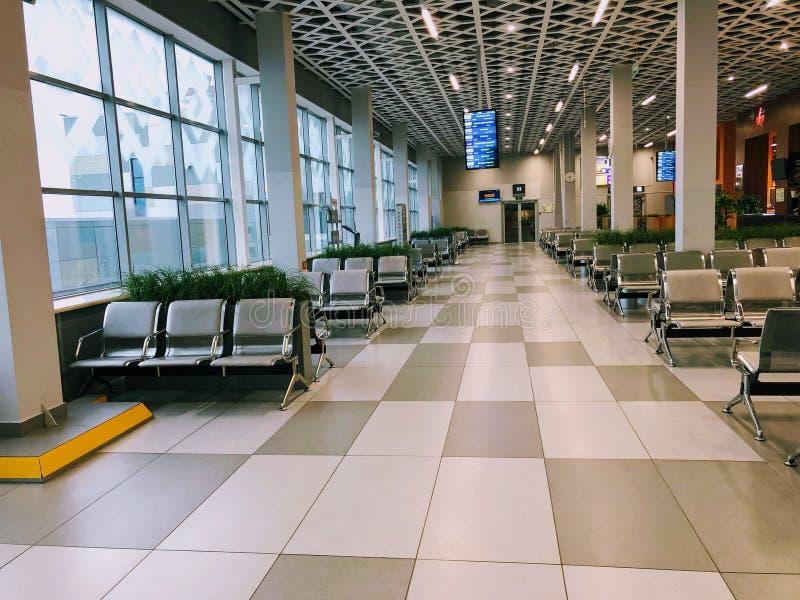 Aeroporto Russia, sala di attesa senza gente imbarco fila immagine stock libera da diritti
