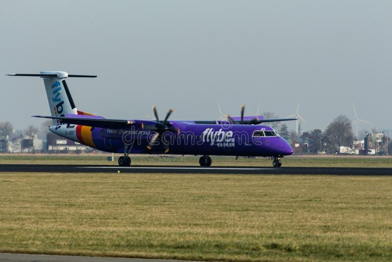Aeropuerto de Schiphol, Holanda Septentrional/los Países Bajos - 16 de febrero de 2019: Flybe de Havilland Canadá DHC-8-400 G-JED fotografía de archivo