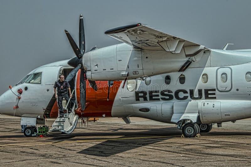 Aerorescue飞机和飞行员 免版税库存照片