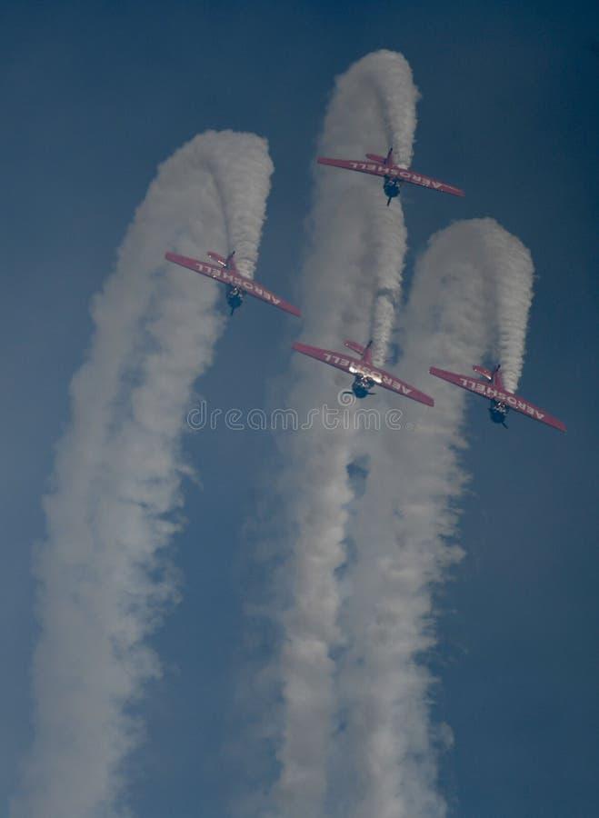 Aeroshell Aerobatic Team Finishing Upside Down Loop royaltyfria foton