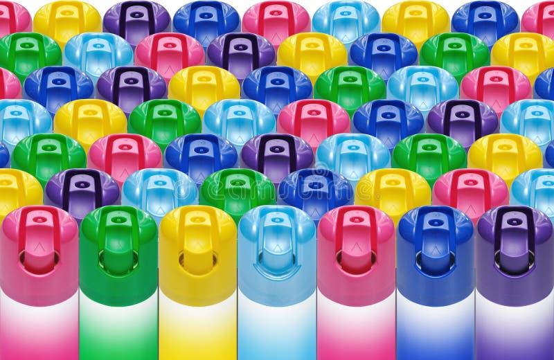 Aerosolowej kiści puszki różnorodni kolory fotografia royalty free