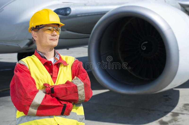 Aerospace engineer. In front of the turbine of a commercial jet plane stock photos