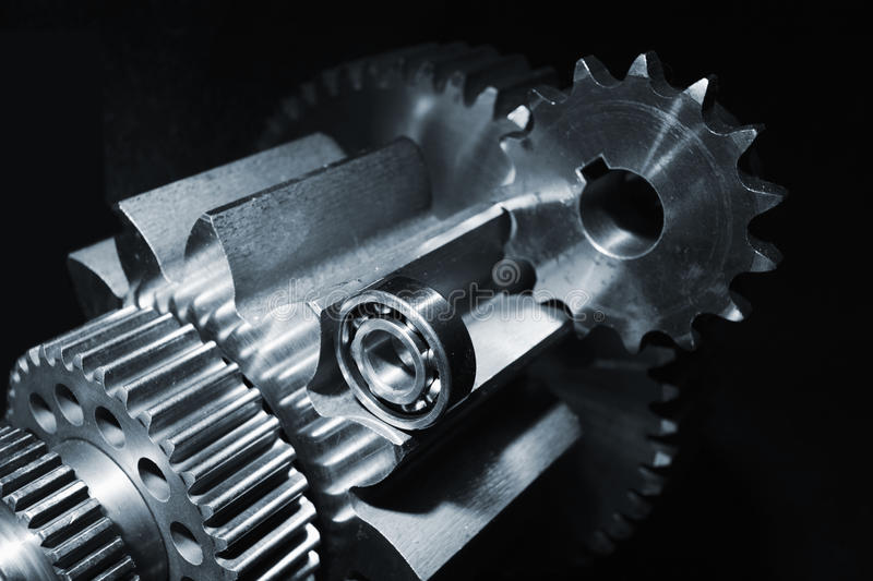 Aerospace gears and ball-bearings. Aerospace gears and cogs set against a black background royalty free stock photography