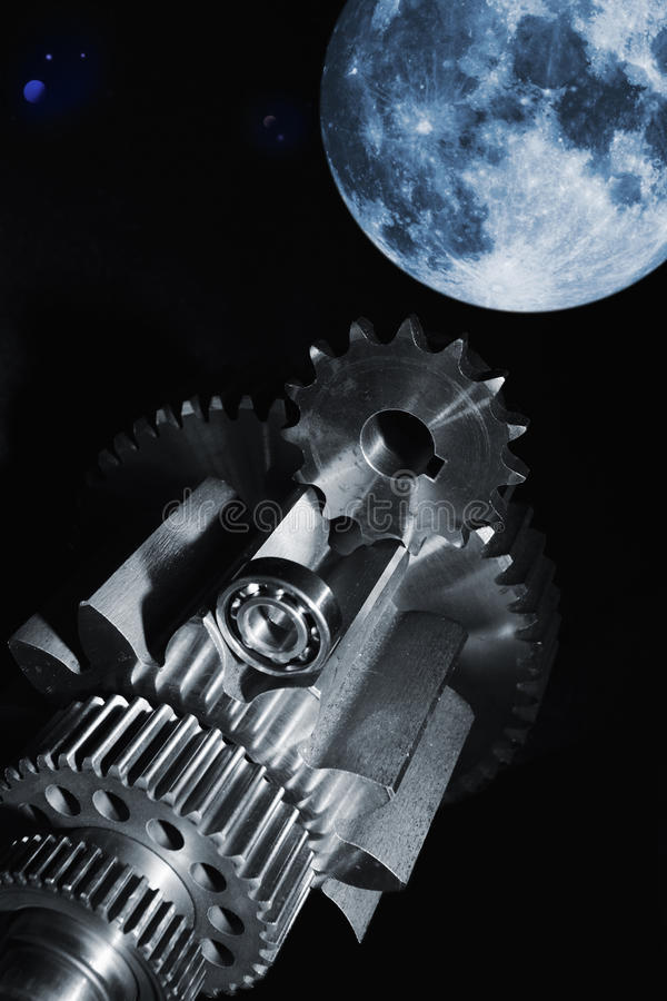 Aerospace gears and ball-bearings. Aerospace gears and cogs set against a black background, large surreal full-moon in background stock photos