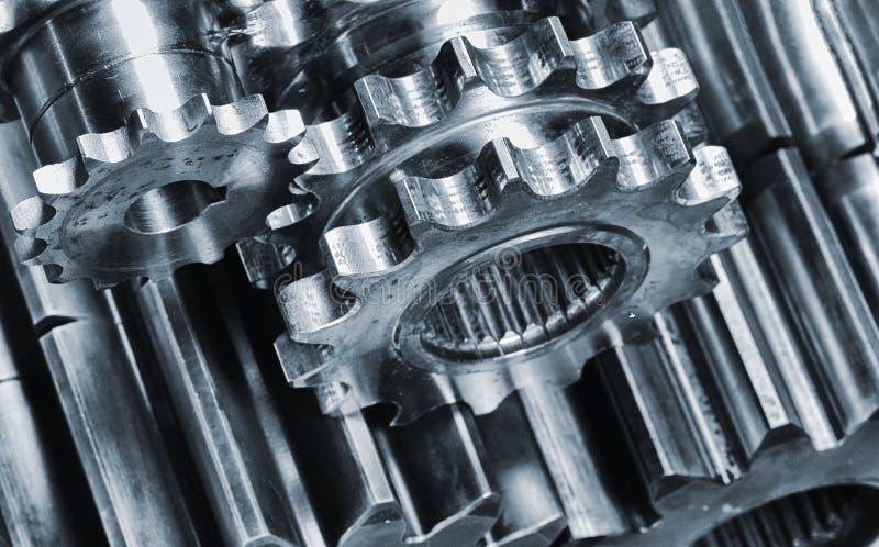 Aerospace gears and titanium cogs. Aerospace geas wheels and cogwheels against aluminum stock images