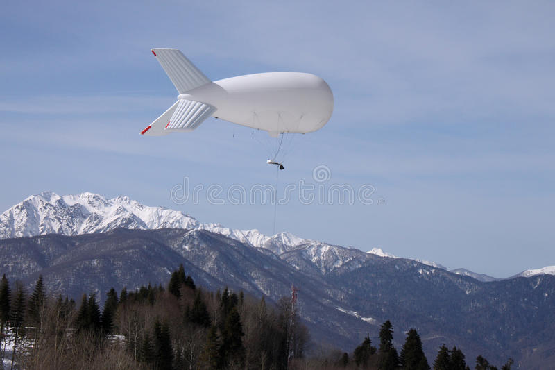Aerostat above mountains. Aerostat with television camera above mountains royalty free stock images