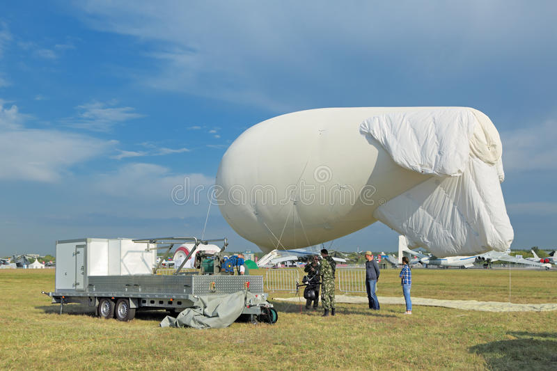 Aerostat for aerial photography. ZHUKOVSKY, MOSCOW REGION, RUSSIA - AUG 26, 2015: The launching of an unmanned aerostat for aerial photography at the stock photography
