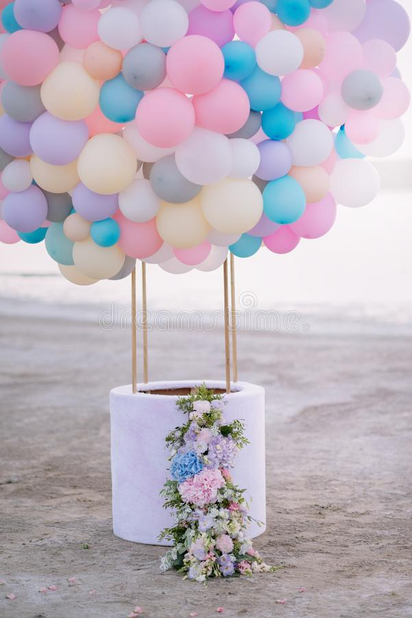 Aerostat from balloons. With a basket decorated with flowers stock image