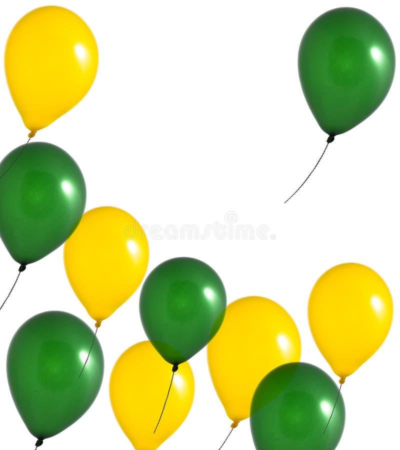 Aerostati gialli e verdi su priorità bassa bianca immagini stock