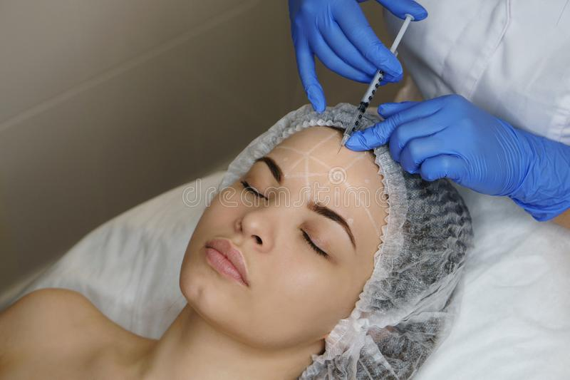 Aesthetic cosmetology. Face lift royalty free stock photography