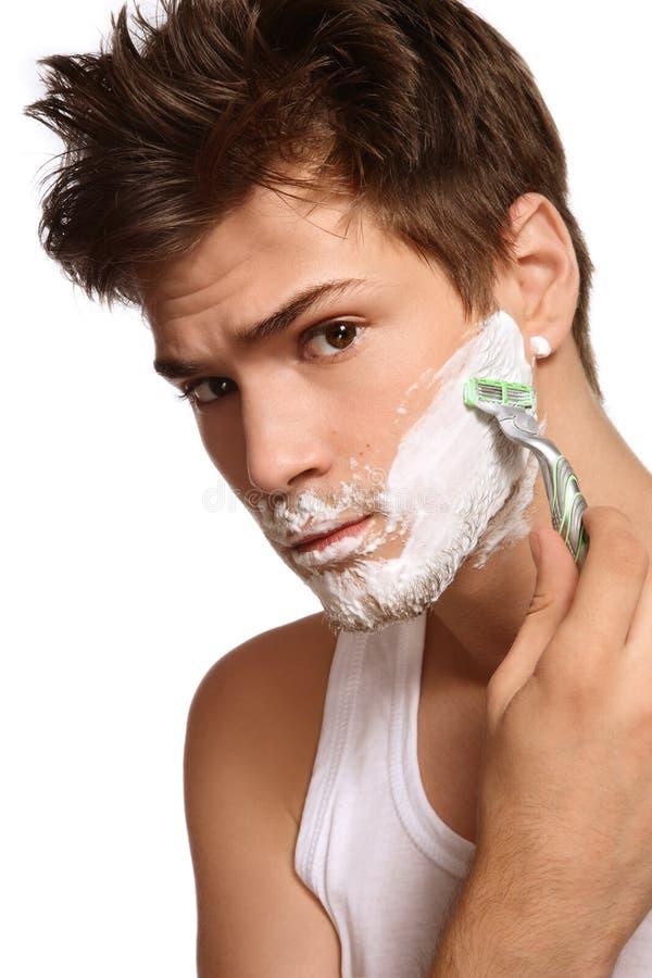 Afeitar al hombre fotos de archivo
