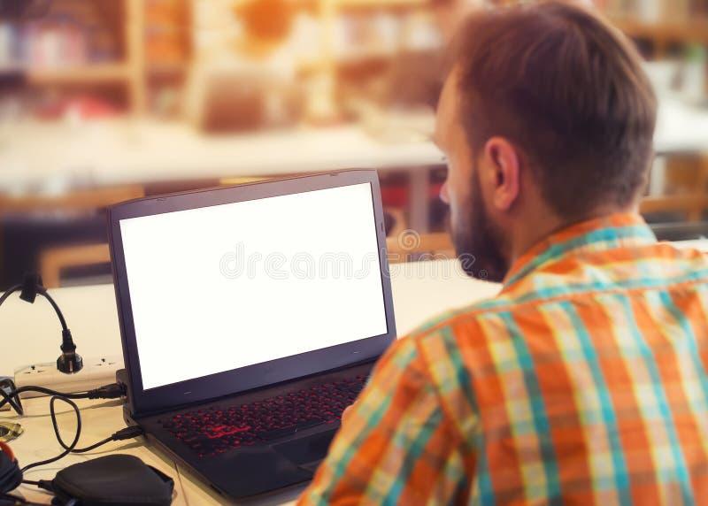 affär hans fungerande barn för bärbar datorman arkivbilder