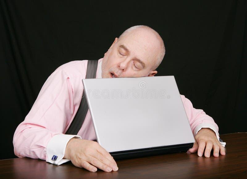 affär hans sova för bärbar datorman royaltyfria foton