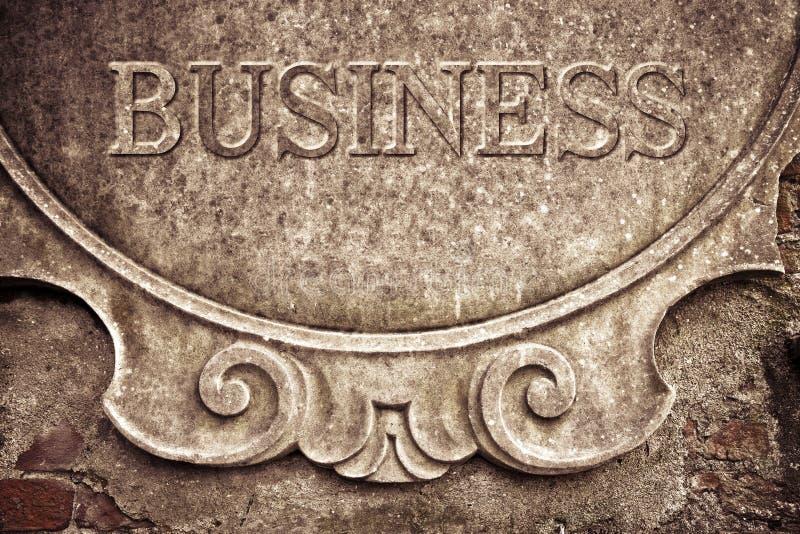 Affär som är skriftlig på stuckaturväggen royaltyfria bilder