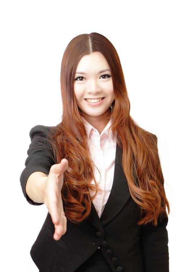 affären hälsar handen som är lyckad till kvinnan royaltyfria foton