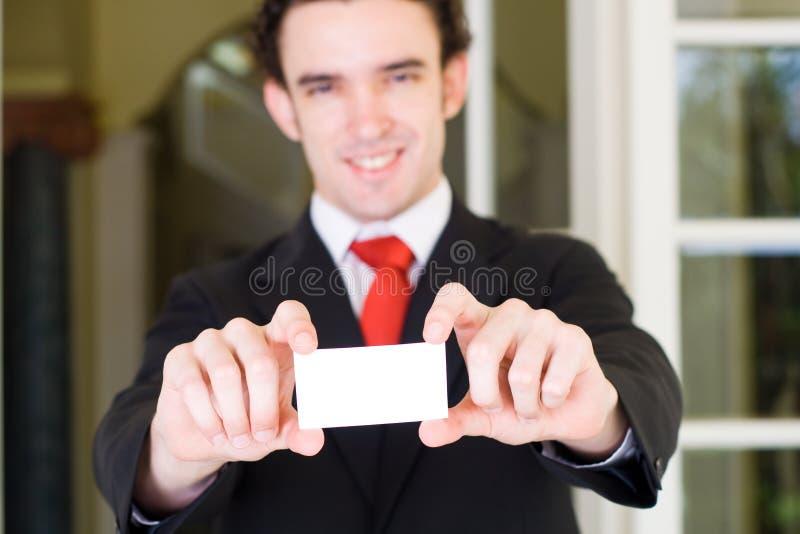 affärsaffärsmankort arkivfoto