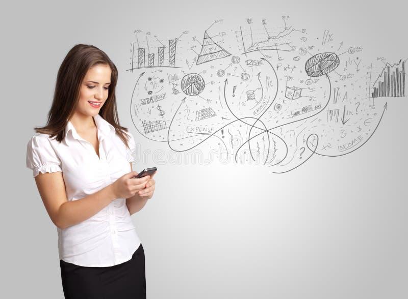 Affärsflickan som framlägger den drog handen, skissar grafer och diagram arkivfoto