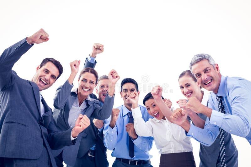 Affärsfolk som i regeringsställning hurrar royaltyfri bild