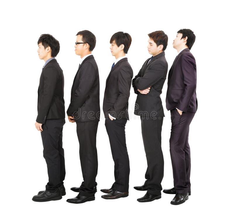 Affärsfolk som står i en fodra arkivbilder